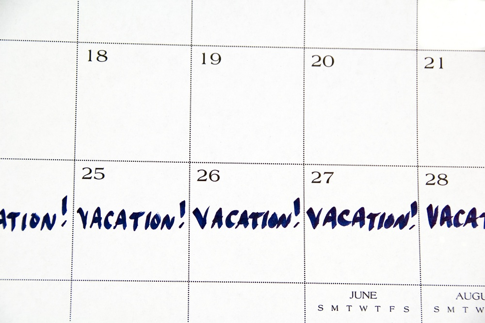 VACATION! written in blue across five days of white monthly calendar